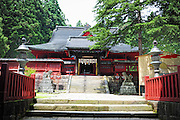 Iwaki shrine on the side of Mt. Iwaki which is a volcano and a very sacred mountain. This is a summer scene of the main shrine building.