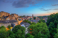 A view of Edinburgh city a summer evening. The area beneath the trees is Dean Village.