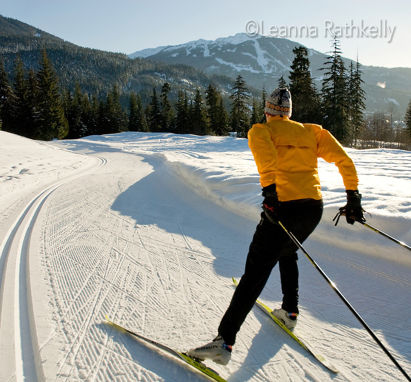 Cross country skier Lee Harrison skates the trails on the Chateau, Lost Lake Trails, Whistler, BC