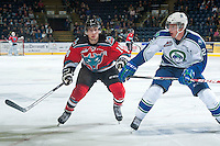 KELOWNA, CANADA - OCTOBER 7: Rourke Chartier #14 of Kelowna Rockets back checks Dillon Heatherington #2 of Swift Current Broncos on October 7, 2014 at Prospera Place in Kelowna, British Columbia, Canada.  (Photo by Marissa Baecker/Getty Images)  *** Local Caption *** Rourke Chartier; Dillon Heatherington;