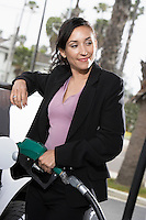 Businesswoman Filling Up at the Gas Station