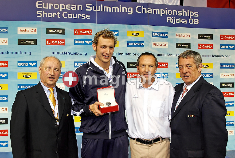 Amaury LEVEAUX (C L) of France wins an Omega watch for the best male performance on day two handed over by Omega represent Andre Saugy (C R) assisted by LEN president Nory Kruchten (L) and LEN Bureau member Francis LUYCE (R) of France during the European Short Course Swimming Championships in Rijeka, Croatia, Friday, Dec. 12, 2008. (Photo by Patrick B. Kraemer / MAGICPBK)