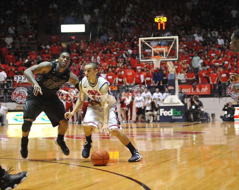 "Ole Miss' Marshall Henderson (22) vs. Missouri's Earnest Ross (33) at the C.M. ""Tad"" Smith Coliseum on Saturday, January 12, 2013. Ole Miss defeated #10 ranked Missouri 64-49."