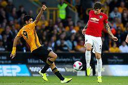 Victor Lindelof of Manchester United takes on Raul Jimenez of Wolverhampton Wanderers - Mandatory by-line: Robbie Stephenson/JMP - 19/08/2019 - FOOTBALL - Molineux - Wolverhampton, England - Wolverhampton Wanderers v Manchester United - Premier League