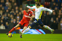 LIVERPOOL, ENGLAND - Wednesday, January 20, 2010: Liverpool's Jamie Carragher and Tottenham Hotspur's Niko Kranjcar in action during the Premiership match at Anfield. (Photo by: David Rawcliffe/Propaganda)