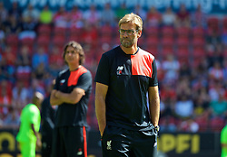 MAINZ, GERMANY - Sunday, August 7, 2016: Liverpool's manager Jürgen Klopp watches his side warm-up as he returns to former club FSV Mainz 05 for a pre-season friendly match at the Opel Arena. (Pic by David Rawcliffe/Propaganda)