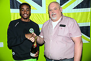 Man of the match Forest Green Rovers Reece Brown(10) with match sponsor KB Coaches during the EFL Sky Bet League 2 match between Forest Green Rovers and Lincoln City at the New Lawn, Forest Green, United Kingdom on 2 March 2019.