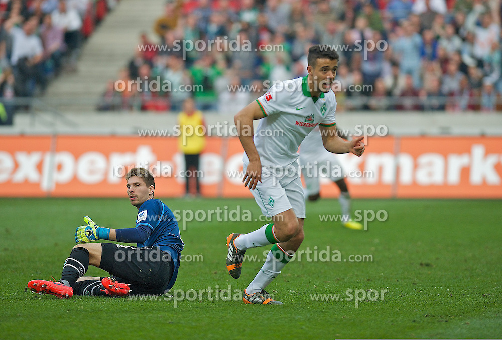 30.03.2014, AWD Arena, Hannover, GER, 1. FBL, Hannover 96 vs SV Werder Bremen, 28. Runde, im Bild Franco Mat�as Di Santo / Franco Matias Di Santo (SV Werder Bremen #9) beim Jubel nach Schuss zum Ausgleichstreffer, Ron-Robert Zieler (Hannover 96 #1) geschlagen am Boden // Franco Mat�as Di Santo / Franco Matias Di Santo (SV Werder Bremen #9) beim Jubel nach Schuss zum Ausgleichstreffer, Ron-Robert Zieler (Hannover 96 #1) geschlagen am Boden during the German Bundesliga 28th round match between Hannover 96 and SV Werder Bremen at the AWD Arena in Hannover, Germany on 2014/03/30. EXPA Pictures &copy; 2014, PhotoCredit: EXPA/ Andreas Gumz<br /> <br /> *****ATTENTION - OUT of GER*****