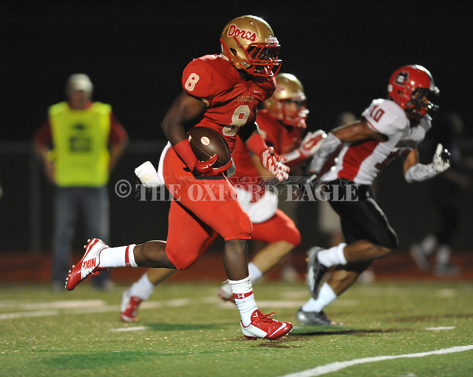 Lafayette High's Tyrell Price (8) runs 55 yards against Shannon in Oxford, Miss. on Friday, September 19, 2014. Lafayette High won 35-0 to improve to 2-3 on the season.