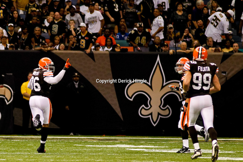 Oct 24, 2010; New Orleans, LA, USA; Cleveland Browns linebacker David Bowens (96) celebrates as he returns an interception for a touchdown during the second half against the New Orleans Saints  at the Louisiana Superdome. The Browns defeated the Saints 30-17.  Mandatory Credit: Derick E. Hingle
