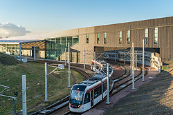 View of tram at modern Edinburgh Gateway railway and tram station that connects Scotrail train passengers with the Edinburgh Tram link  in Edinburgh, Scotland, United Kingdom.