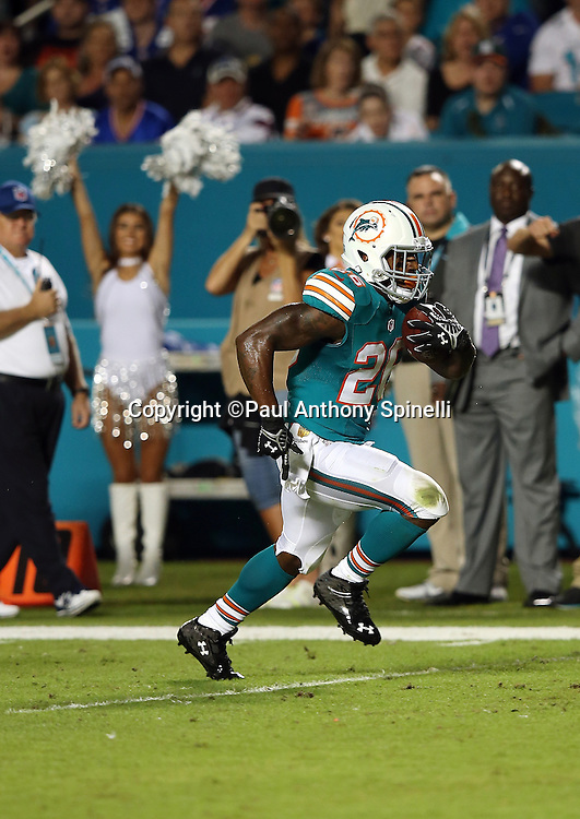 Miami Dolphins running back Lamar Miller (26) runs for a 14 yard first quarter touchdown good for a 7-3 Dolphins lead during the NFL week 14 regular season football game against the New York Giants on Monday, Dec. 14, 2015 in Miami Gardens, Fla. The Giants won the game 31-24. (©Paul Anthony Spinelli)
