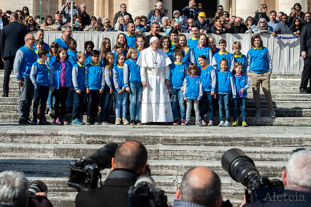 Vatican City - MARCH 06, 2019: Pope Francis poses for a picture with Children's Choir at the end of his weekly general audience in St. Peter's Square at the Vatican.