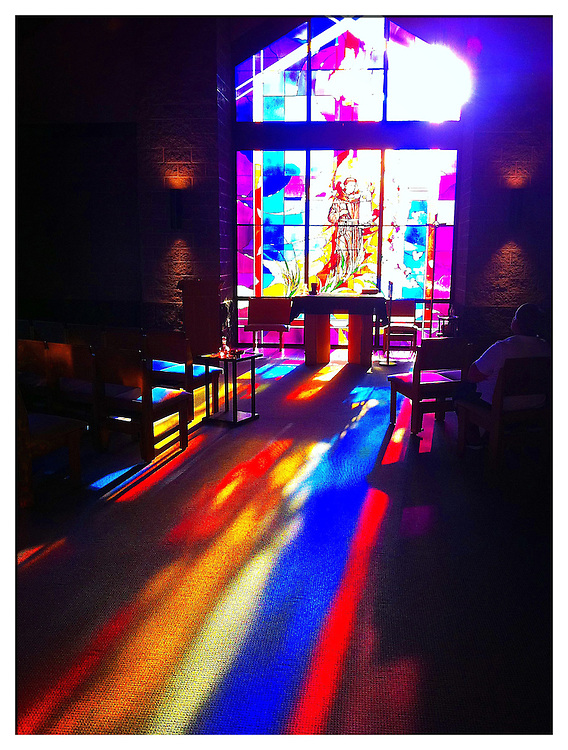 Reflections from stained glass windows inside chapel at St. Mary Church in De Pere, Wis. Taken with ProCamera app, sharpening with PS Express app. (Photo by Sam Lucero)