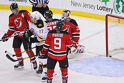 Jan 19; Newark, NJ, USA; Boston Bruins left wing Milan Lucic (17) celebrates Boston Bruins right wing Nathan Horton (18) game winning goal during the third period at the Prudential Center.   The Bruins defeated the Devils 4-1.