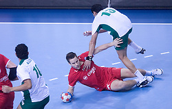 Michael V. Knudsen of Denmark  vs  Mustafa Alhabib of Saudi Arabia during 21st Men's World Handball Championship preliminary Group D match between Denmark and Saudi Arabia, on January 19, 2009, in Arena Zatika, Porec, Croatia. (Photo by Vid Ponikvar / Sportida)