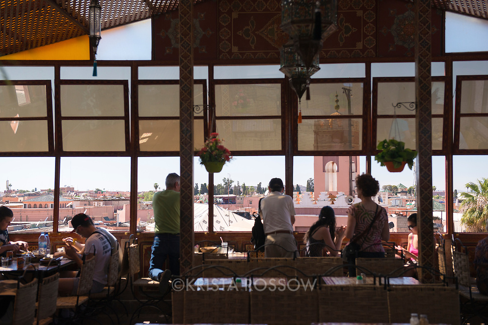 Diners admire the view of Jemaa el-Fnaa from a restaurant in the Medina of Marrakesh, Morocco.
