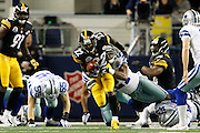 Pittsburgh Steelers running back Chris Rainey (22) is tackled by Dallas Cowboys cornerback Mike Jenkins (21) at Cowboys Stadium in Arlington, Texas, on December 16, 2012.  (Stan Olszewski/The Dallas Morning News)