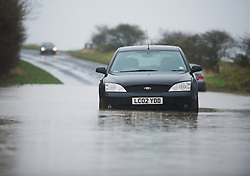 © Licensed to London News Pictures. 25/11/2012..North East England..An abandoned car that became stuck in deep water near to Staithes in North Yorkshire this morning following heavy overnight rain that caused traffic disruption and flooding in parts of Cleveland and North Yorkshire...Photo credit : Ian Forsyth/LNP
