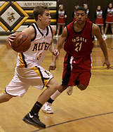 The Knights J.J. Laumann (3) drives to the basket as the LaSalle Lancers play the Alter High School Knights in varsity basketball, Friday Night, January 26, 2007, at Alter's Joe Petrocelli Gymnasium.