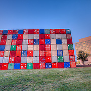 "Temporary conceptual art display at Penn Valley Park in Kansas City, Missouri of shipping containers that say ""USA"" and IOU"" on public parkland right across the street from the Kansas City Federal Reserve."