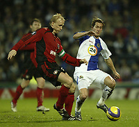 Photo: Aidan Ellis.<br /> Blackburn Rovers v Bayer Leverkusen. UEFA Cup, 2nd Leg. 22/02/2007.<br /> Rovers Morten Gamst Pedersen (R) challenges Bayer's Carsten Ramelow