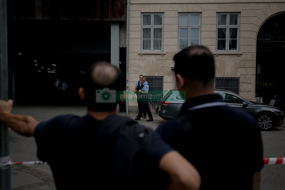 May 28, 2017 - Copenhagen, Denmark - Copenhagen Police officers have evacuated Magasin du Nord, a popular shopping centre and tourist attraction in central Copenhagen due to a bomb threat on 28 May 2017. Police dog patrols and the bomb squad are present at the scene. The city has been on high alert since the terror attack on February 15, 2015 which killed a jewish security guard and a film director. (Credit Image: © Aleksander Klug/NurPhoto via ZUMA Press)