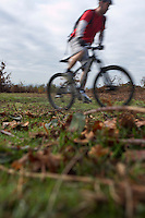 Man riding mountain bike in countryside