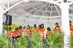 "Students of Bertha C. Boschulte's Flambo Combo play for the crowd.  ""Alvin's Cultural Workshop"" Cultural Fair honoring Mr. Alvin Turnbull.  Emancipation Garden.  St. Thomas, VI.  29 April 2015.  © Aisha-Zakiya Boyd"