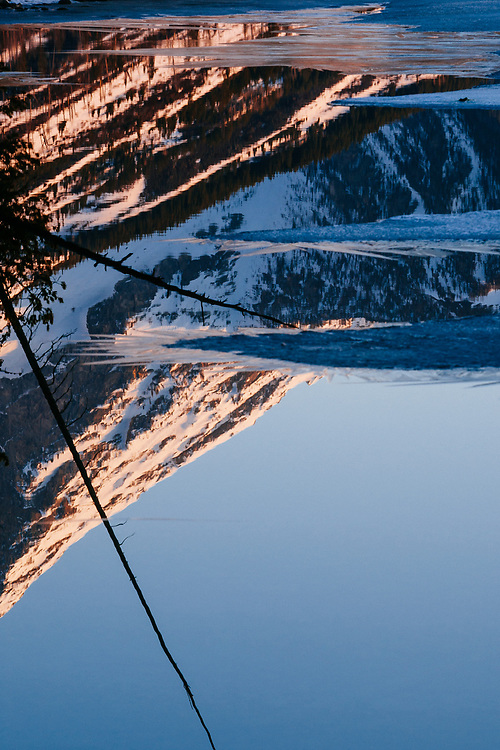 An abstract reflection of the Teton Mountain Range in Jenny Lake at sunrise in Grand Teton National Park.