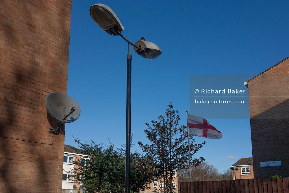 The English flag flies in a garden on a hosing estate, on 28th November 2016, near Camberwell, south London borough of Southwark, England.