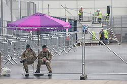 © licensed to London News Pictures. London, UK 14/07/2012.Troops waiting at the Olympic site in Stratford today. Photo credit: Tolga Akmen/LNP