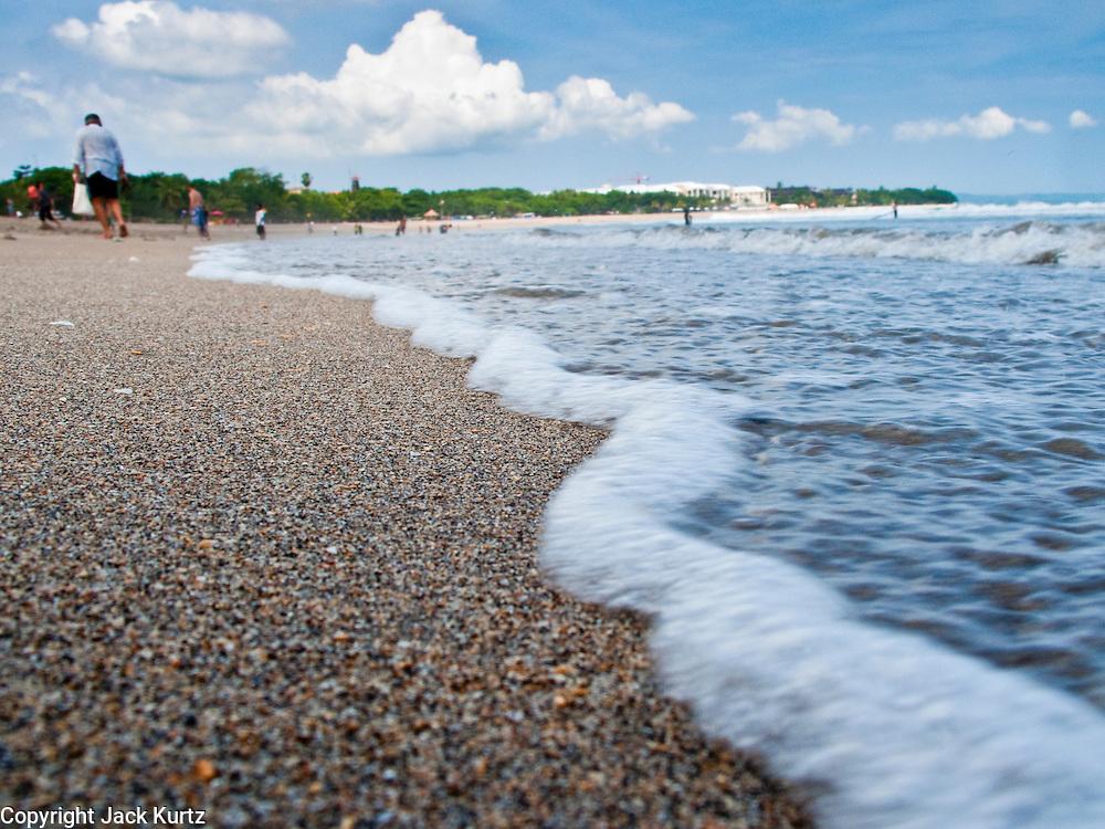 Apr 24 - KUTA, BALI - Waves roll in on Kuta beach, one of Bali's most famous beaches in Kuta, Bali, Indonesia. Photo by Jack Kurtz/ZUMA Press