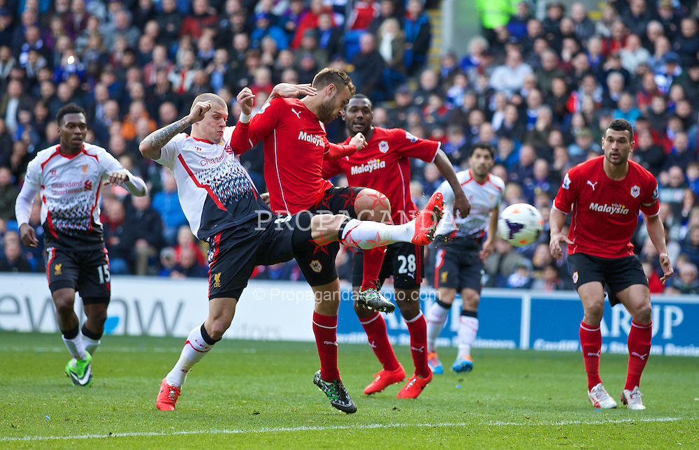 CARDIFF, WALES - Saturday, March 22, 2014: Liverpool's Martin Skrtel scores the second goal against Cardiff City during the Premiership match at the Cardiff City Stadium. (Pic by David Rawcliffe/Propaganda)