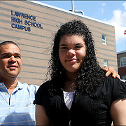 """I compare myself to a turtle"" says Arquianys Martinez, 15,. She will receive her high school diploma from Lawrence High School on June7/2009. <br /> <br /> Arquianys, originally from Dominican Republic came to US when she was 8 years old.<br /> <br /> She managed to learned English while enrolled in several after-school programs. This photo shows her with Arquimedes Martinez, her father."