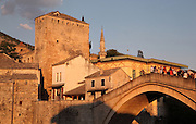 Stari Most or Old Bridge, a 16th century Ottoman bridge across the Neretva river, in Mostar, Bosnia and Herzegovina. The bridge was destroyed in the 1990s Yugoslavian war and has been rebuilt. The town is named after the mostari or bridge keepers of the Old Bridge. Mostar developed in the 15th and 16th centuries as an Ottoman frontier town and is listed as a UNESCO World Heritage Site. Picture by Manuel Cohen