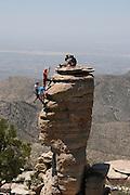 Rock climbers scale the General Hitchcock Monument at Windy Point Vista on Mount Lemmon, Santa Catalina Mountains, Coronado National Forest, Sonoran Desert, Tucson, Arizona, USA.