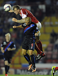Bristol City's Aden Flint  battles for the high ball with Crystal Palace's Kevin Phillips  - Photo mandatory by-line: Joe Meredith/JMP - Tel: Mobile: 07966 386802 27/08/2013 - SPORT - FOOTBALL - Ashton Gate - Bristol - Bristol City V Crystal Palace -  Capital One Cup - Round 2