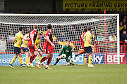 Oxford goalkeeper Benjamin Büchel spills the ball before Crawley Town Defender Joe McNerney taps in to make it 1-0 during the Sky Bet League 2 match between Crawley Town and Oxford United at the Checkatrade.com Stadium, Crawley, England on 9 April 2016. Photo by David Charbit.