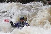 061210-Morrison, COLORADO-wildwaterart-Kayaker Bridger Steele, of Denver, maneuvers through the white water rapids Saturday, June 12, 2010 on Bear Creek. Heavy rain fall at higher elevations has caused the normally peaceful creek to swell. .Photo By Matthew Jonas/Evergreen Newspapers/Photo Editor