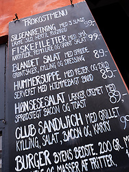 Menu board outside restaurant in Nyhavn district of Copenhagen Denmark