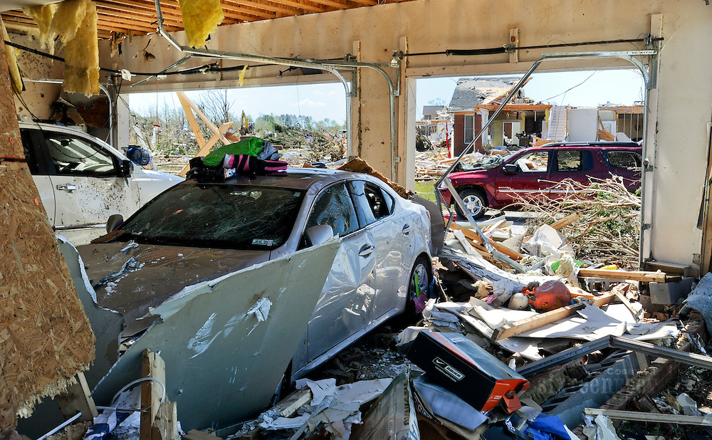 Daily Photo by Gary Cosby Jr.  ..Volunteers fanned out through the destroyed East Limestone communities devastated by Wednesday's tornado.  Devastated homes are seen through a garage on another devastated home in Magnolia Terrace.