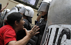 59594103  .A woman argues with policemen during a demonstration to commemorate the International Labour Day in San Jose, capital of Costa Rica, on May 1, 2013,  May 2, 2013 Photo by: i-Images.UK ONLY
