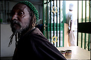 """Joseph Patrick, a fifties jamaikan Rasta, is at """"One Two"""" fast food restaurant, waiting for jamaican typical food. This business, faced on the main road of the town, is run by two jamaican people..Many members of the ethiopian Rasta community, among them in Shashemene, are owners of shops and activities. South Ethiopia, on saturday, March 22 2008.....""""Shashamene or Shashemene (ethiopian name), located in the Oromia Region of Ethiopia, is """"the place"""", the ancestral homeland. For the whole Rastafarians repatriation to Africa or to Zion or to the Promise Land is the first goal. Rastas assert that """"Mount Zion"""" is a place promised by Jah and they  claim themselves to represent the real Children of Israel in modern times. During the last years of the 40's, Emperor Haile Selassie I, considerated from that movement incarnation of God, donated 500 acres of his private land to members and other settlers from Jamaica including other parts of the Caribbean..The Rastafarian settlement in Shashamane was recently reported to exceed two hundred families. In January 2007 it organized an exhibition and a bazaar in the city. It was also reported recently prior to the Ethiopian Millennium that various pro-Ethiopian World Federation groups, consisting of indigenious Ethiopians and Rastafarians, have given support to one of many five year plans proposed for sustainable development of Shashamene, Ethiopia."""""""