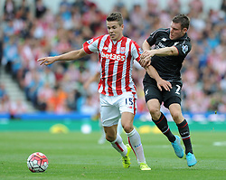 Marco van Ginkel of Stoke City is challenged by James Milner of Liverpool - Mandatory byline: Dougie Allward/JMP - 07966386802 - 09/08/2015 - FOOTBALL - Britannia Stadium -Stoke-On-Trent,England - Stoke City v Liverpool - Barclays Premier League