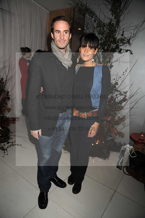JOSEPH FIENNES and MARIA DOLORES DIEGUEZ at a reception before the launch of the English National Ballet Christmas season launch of The Nutcracker held at the St,Martins Lane Hotel, London on 5th December 2008.