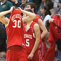 West Middlesex's Roman Klaric pulls his jersey over his head to hide his emotions after the Big Reds fell to the Beaver Falls Tigers, 59-47, in the PIAA Class AA final four match up at Sharon High School on Tuesday, March 19, 2013.