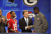 Show host Pat Sajak with Tampa Bay Buccaneers wide receiver Keyshawn Johnson appears on NFL Players Week on Wheel of Fortune on 11/04/2003. ©Paul Anthony Spinelli