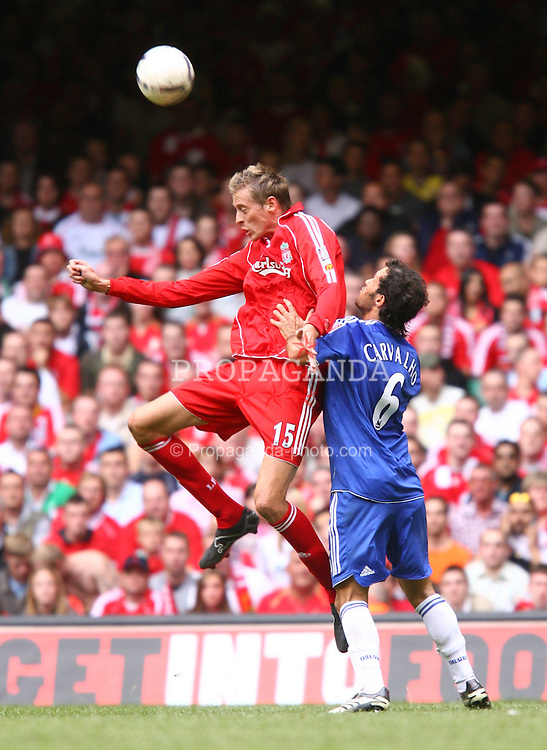 CARDIFF, WALES - SUNDAY, AUGUST 13th, 2006: Liverpool's Peter Crouch and Chelsea's Ricardo Carvalho during the Community Shield match at the Millennium Stadium. (Pic by David Rawcliffe/Propaganda)
