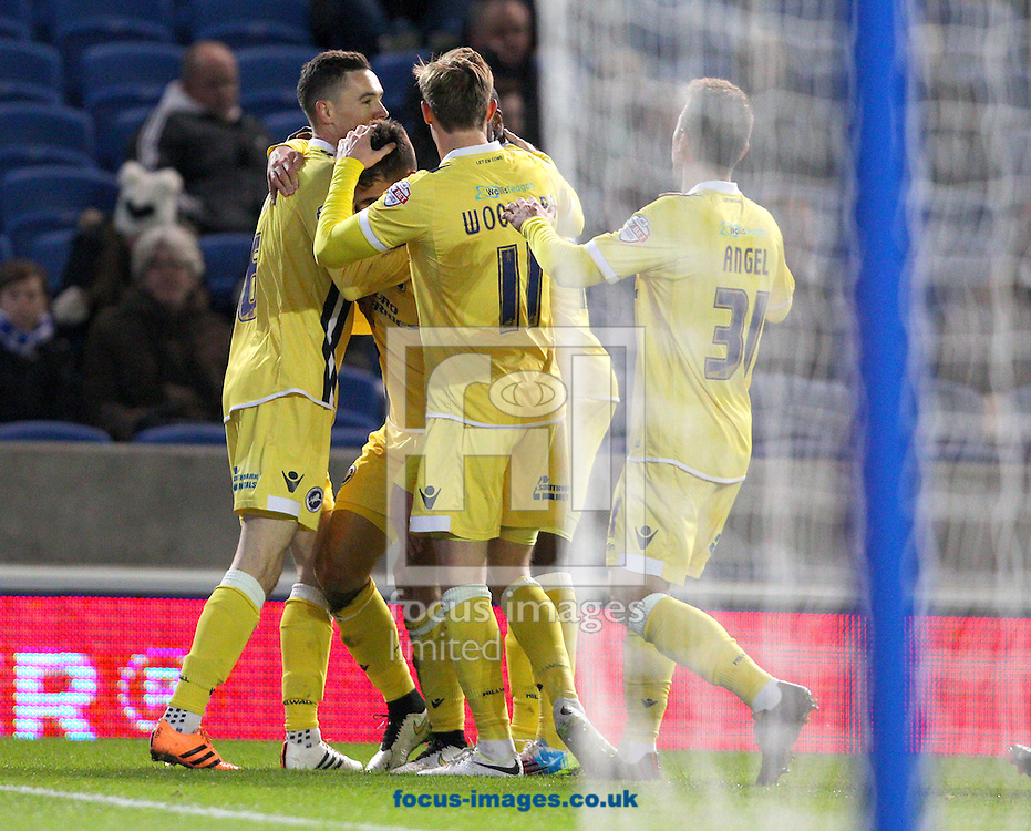 Lee Gregory ( 2nd L ) of Millwall celebrates with team mates after he scores the opening goal during the Sky Bet Championship match at the American Express Community Stadium, Brighton and Hove<br /> Picture by Paul Terry/Focus Images Ltd +44 7545 642257<br /> 12/12/2014